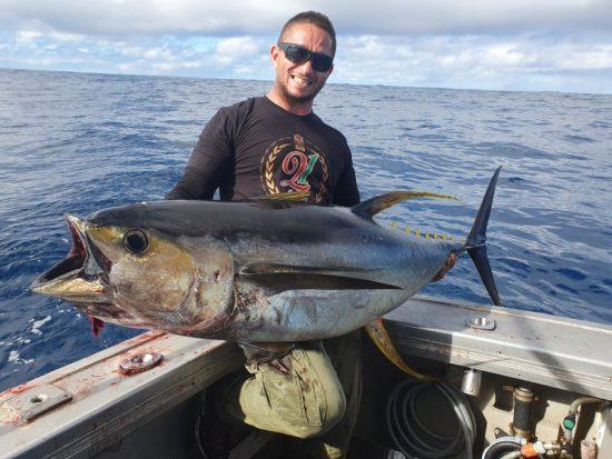 Man catching fish on Wahoo Fishing Charters